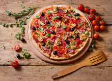 Fresh pizza on wood Royalty Free Stock Image