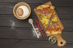 Fresh pizza on a wooden cutting board. Royalty Free Stock Photos
