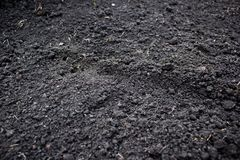 Fresh plowed earth. As the background Royalty Free Stock Photo