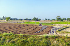 Fresh plowed fields in India Stock Photos