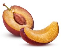 Fresh plum cut in half with bone and slice Royalty Free Stock Photography