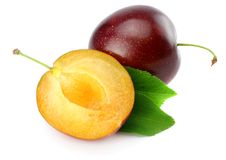 Fresh plum fruit with cut plum slices isolated on white background stock images