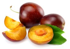 Fresh plum fruit with cut plum slices isolated on white background royalty free stock photos