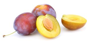 Fresh plum fruit with cut plum slices isolated on white background stock photo