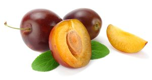 Fresh plum fruit with cut plum slices isolated on white background royalty free stock photo