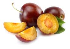 Fresh plum fruit with cut plum slices isolated on white background stock image