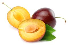 Fresh plum fruit with green leaf and cut plum slices isolated on white background stock photos