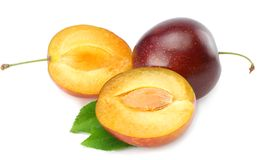 Fresh plum fruit with green leaf and cut plum slices isolated on white background stock image