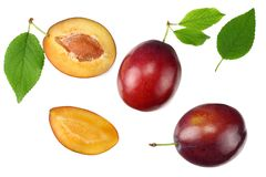 Fresh plum fruit with green leaf and cut plum slices isolated on white background. top view stock photo