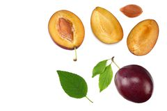 Fresh plum fruit with green leaf and cut plum slices isolated on white background. top view stock photography