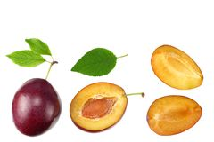 Fresh plum fruit with green leaf and cut plum slices isolated on white background. top view royalty free stock photos