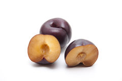 Fresh plum halves Royalty Free Stock Images