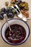 Fresh plum jam in an enamel bowl Stock Photo