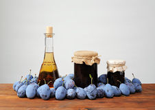 Fresh plum, schnapps and plum jam Royalty Free Stock Photography