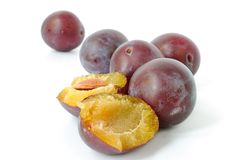 Fresh plums. Group of fresh plums on white background. Closeup Stock Image