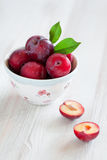 Fresh plums. In bowl on the table, selective focus Royalty Free Stock Image
