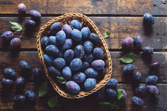 Fresh plums in a basket Stock Photo