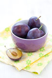 Fresh plums in bowl. On napkin Royalty Free Stock Photography