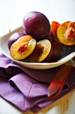 Fresh plums in a bowl. Closeup of fresh ripe plums ina bowl Royalty Free Stock Photo