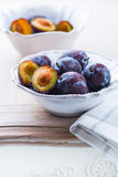Fresh plums in a bowl Stock Photography