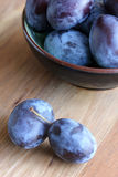 Fresh plums in a bowl Royalty Free Stock Image