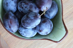 Fresh plums in a bowl Stock Photos