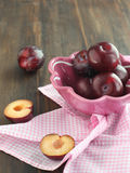 Fresh plums in a bowl. Fresh ripe plums in a bowl Royalty Free Stock Photo