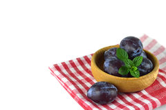 Fresh plums in the bowl. Fresh plums in the wooden bowl Royalty Free Stock Photo