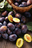 Fresh plums on brown wooden background Stock Image