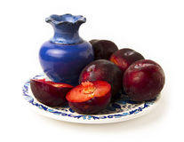 Fresh plums on ceramic plate Royalty Free Stock Images