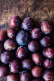 Fresh plums on a dark wooden table.Ripe Plums Texture over vint Stock Photography