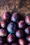 Fresh plums on a dark wooden table.Ripe Plums Texture over vint Royalty Free Stock Photography