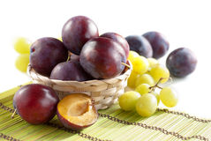 Fresh plums and grapes Royalty Free Stock Photography