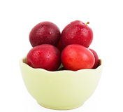 Fresh plums in green deep bowl Royalty Free Stock Photography