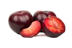 Red plum with slice. Fresh plums with half and slice on white background Royalty Free Stock Photos