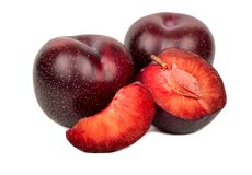 Red plum with slice. Fresh plums with half and slice on white background Stock Image