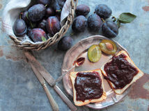 Fresh plums and homemade plum jam on bread Royalty Free Stock Photography