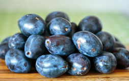 Fresh plums in the kitchen Royalty Free Stock Images