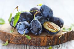 Fresh plums with leaves Royalty Free Stock Image