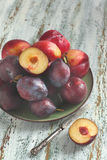Fresh plums on a plate Stock Photos