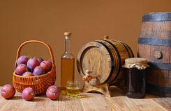 Fresh plums with plum brandy and jam Royalty Free Stock Image