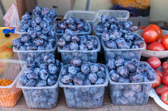 Fresh plums for sale at the market Stock Photos
