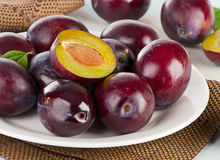 Fresh plums on a white plate Stock Image