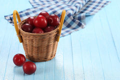 Fresh plums in a wicker basket Royalty Free Stock Image