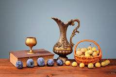Fresh plums in a wicker basket Stock Photos