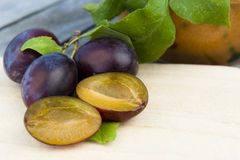Fresh Plums on wood Royalty Free Stock Photography