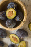 Fresh plums on wooden background Royalty Free Stock Photo