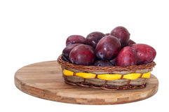 Fresh plums in the wooden basket Stock Photography