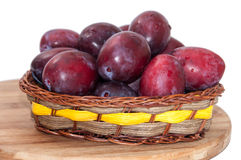 Fresh plums in the wooden basket Royalty Free Stock Image