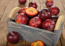 Fresh plums in a wooden box Stock Images